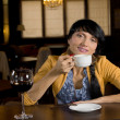 Woman relaxing drinking coffee at the bar — Stock Photo