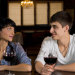 Smiling young couple on a date out drinking — Stock Photo #36238609