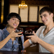 Attractive young couple posing at the bar — Stock Photo #36238625
