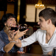 Romantic young couple toasting with red wine — Stock Photo