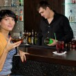 Beautiful Hispanic woman drinking at the bar — Stock Photo #36238721