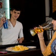 Young woman chatting to the barman — Stock Photo #36238763