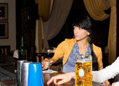 Brunette woman sitting at the bar feeling lonely — Stock Photo