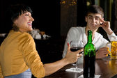 Optimistic woman drinking red wine at the bar — Stock Photo