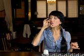 Woman downing a glass of neat vodka — Stock Photo