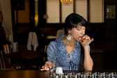 Woman licking a salt chaser at the bar — Stock Photo