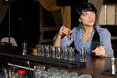 Woman drinking vodka shots at a bar — Stock Photo