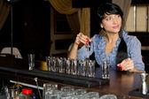 Woman drinking vodka shots at a bar — Stock Photo