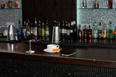 Cup of coffee on a bar counter — Stock Photo