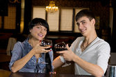 Attractive young couple posing at the bar — Stock Photo