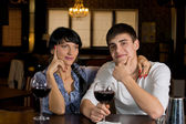 Couple sitting at the bar drinking red wine — Stock Photo