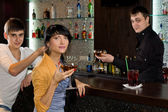 Two young friends relaxing in a pub — Stock Photo