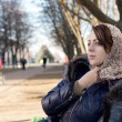 Lonely young woman sitting on a park bench — Stock Photo #36785261