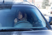 Dangerous irresponsible female driver — Stock Photo