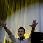 Happy disc jockey performing at a party — Stock Photo #37677189