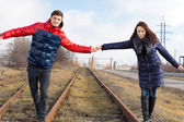 Young couple waiting for the train — Stock Photo