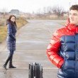 Stock Photo: Young mwaiting in road with suitcase