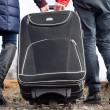 Couple pulling a suitcase along a stony path — Stock Photo