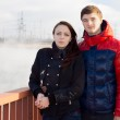 Attractive young couple standing on a promenade — Stock Photo