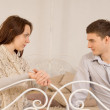 Young couple sitting having a private discussion — Stock Photo