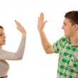 Young couple giving themselves a high fives — Stock Photo #41872167