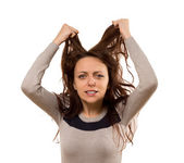 Woman tearing at her hair in desperation — Stock Photo