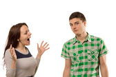 Excited young woman gesturing at her boyfriend — Stock Photo