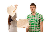 Young woman tossing aside papers — Stock Photo