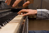 Concert pianist playing the piano — Stock Photo