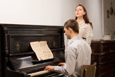 Young couple practicing a musical duet — Stock Photo