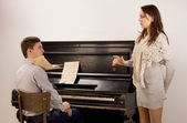 Young couple practicing a classical duet — Stock Photo