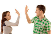 Young couple giving themselves a high fives — Stock Photo
