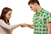 Young couple gently knocking knuckles — Stock Photo