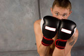 Young boxer protecting his face and head — Stock Photo