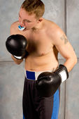 Young boxer adjusting his mouth guard — Foto de Stock