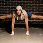Постер, плакат: Young boxer exercising during a workout