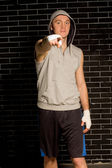 Young boxer pointing at the camera — Fotografia Stock