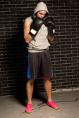 Anxious young boxer standing waiting for his match — Stock Photo