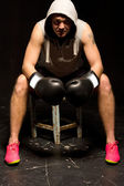 Boxer sitting in his corner between rounds — Stock Photo