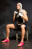 Thoughtful young boxer waiting for a match — Stock Photo