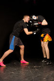 Two young boxers sparring in the ring — Stock Photo
