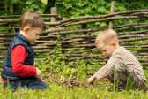 Two young boys playing at lighting a campfire — Stock Photo