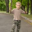 Cute little boy practising stick fighting — Stock Photo #45308753
