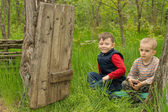 Two handsome young boys playing in woodland — Stock Photo