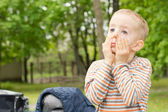 Little boy pulling a droopy eyed face — Stock Photo
