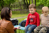 Woman having a serious talk with a small boy — Stock Photo