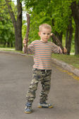 Cute little boy practising stick fighting — Stock Photo