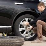 Mechanic changing a wheel — Stock Photo #46244037