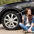 Perplexed woman waiting for roadside assistance — Stock Photo #46244135