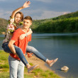 Young couple having a piggy back ride — Stock Photo #46244441